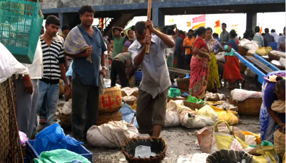 Image of a man in a busy market from an international video research production