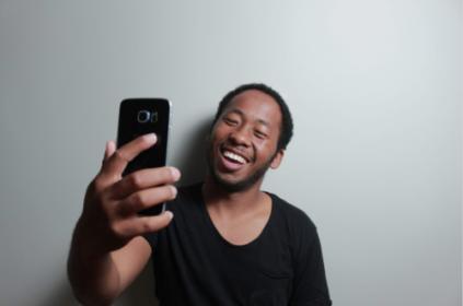 Man taking selfie video.